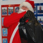 with a full sack of presents santa bids goodbye